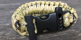 Desert camp survival bracelet with whistle and fire starter